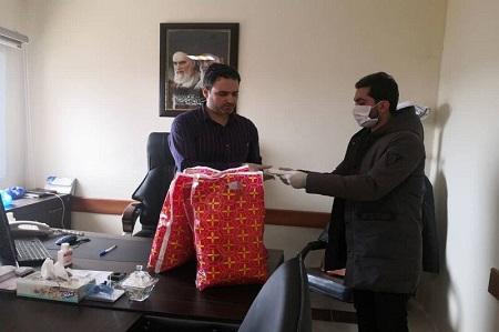 سازمان مردم نهاد در بیمارستان آستارا ماسک توزیع کرد